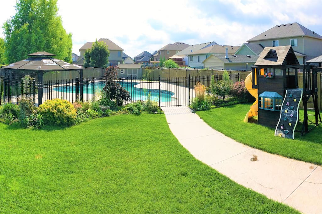 Backyard view: equipped with a very nice swimming pool and play area for kids