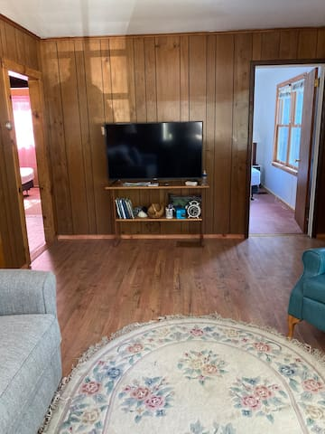 Fire stick 50 inch tv front bedroom on the right rear bedroom on the left .