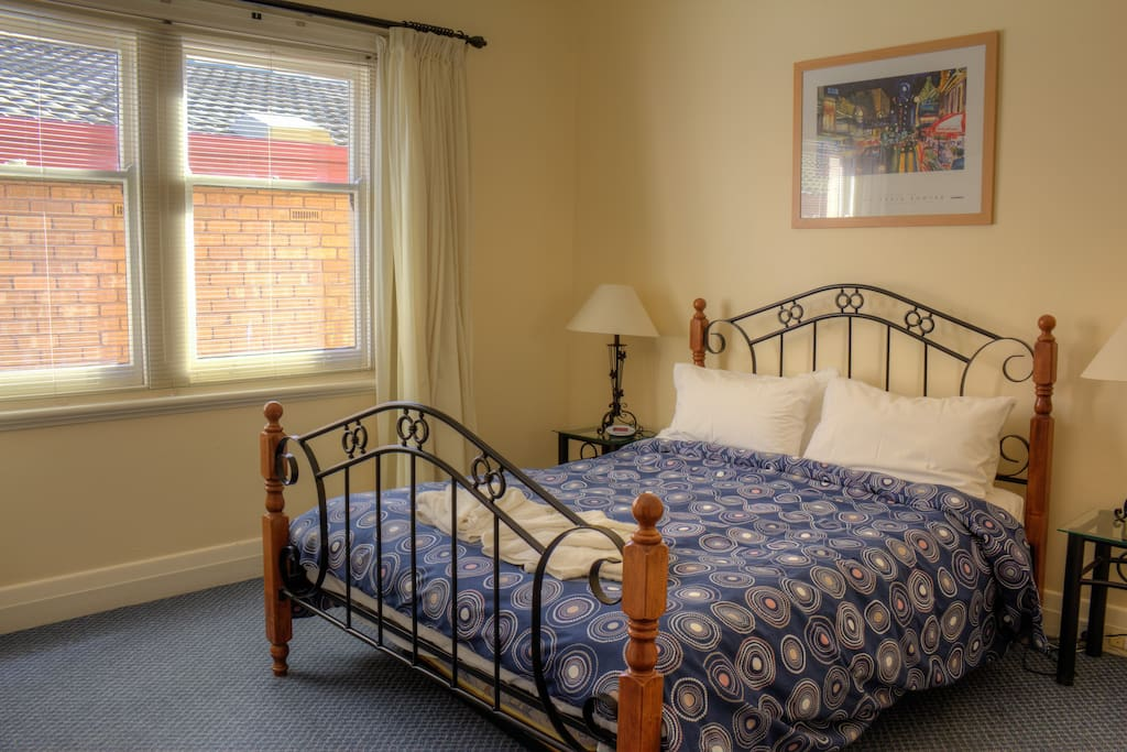 large main bedroom with Queen bed, BIR & optional trundle bed or cot available at request