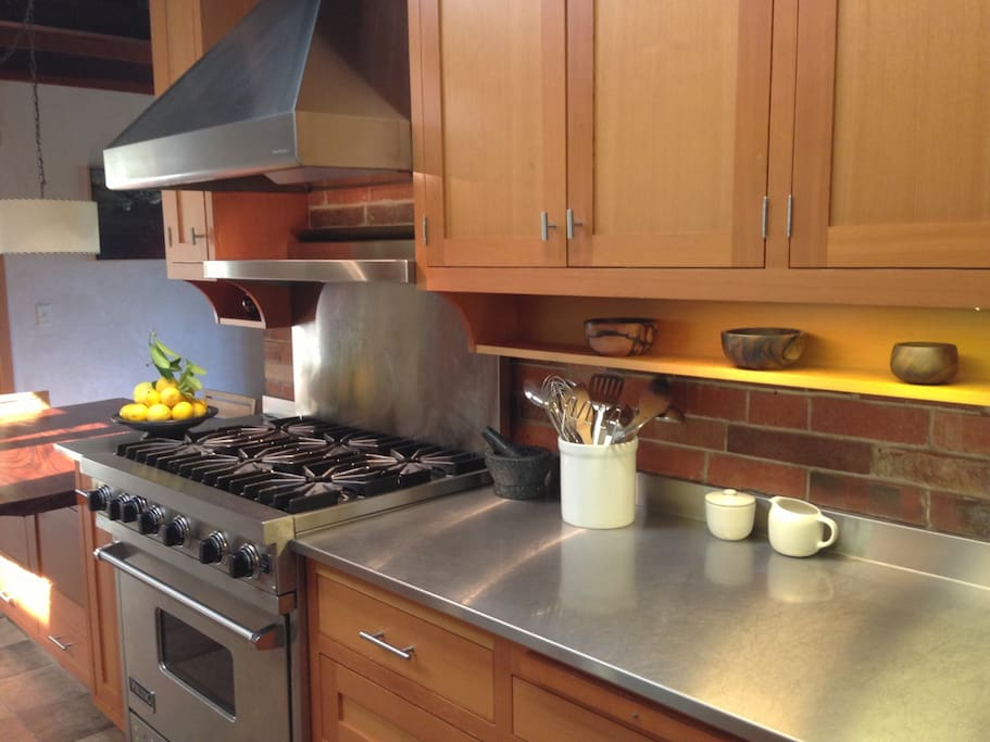 Chef's kitchen outfitted with a 6 burner Viking range and All Clad cookware.