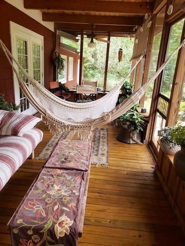 Screened Florida Room with lounging hammocks