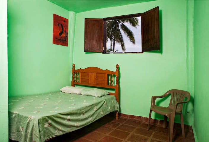 Feel the breeze and listen to the ocean. Clean room with fresh coat of paint.