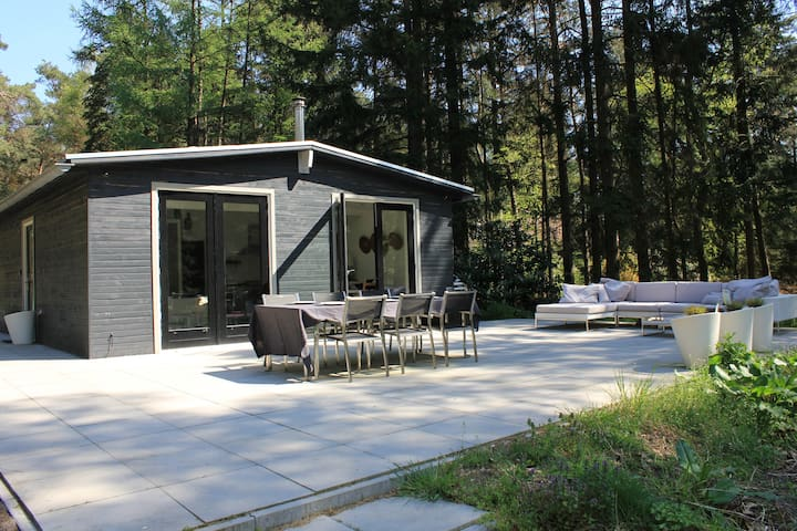 Holiday home on own grounds in woodland setting