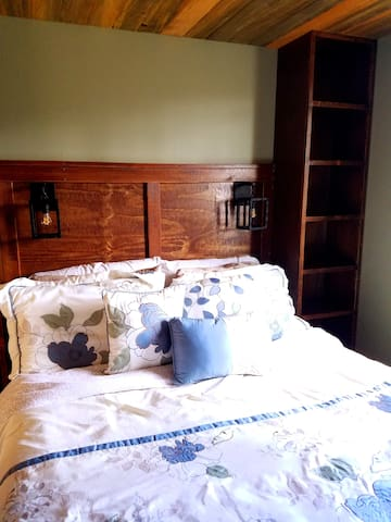 Convenient overhead lighting. Shelf space galore, on both sides of the bed.