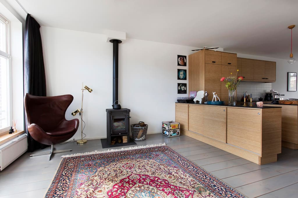lounge area with wood stove for cosy afternoons & evenings