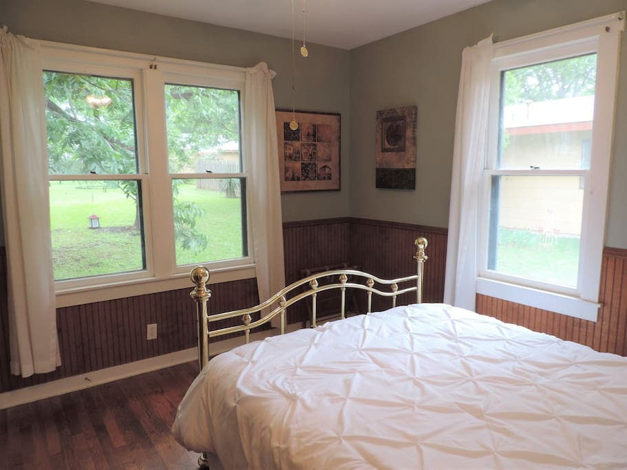 Queen Bedroom with lots of natural light and a great view of the backyard
