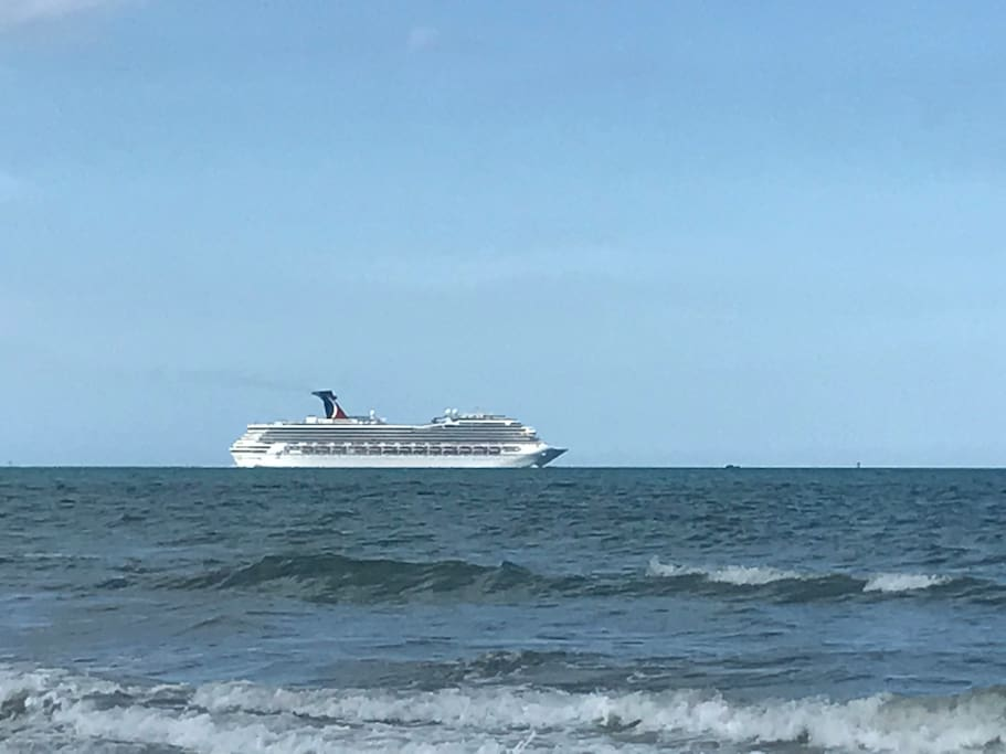 Watching the cruise ships take off from our beach!