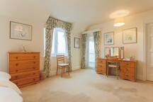 A delightful bedroom well furnished