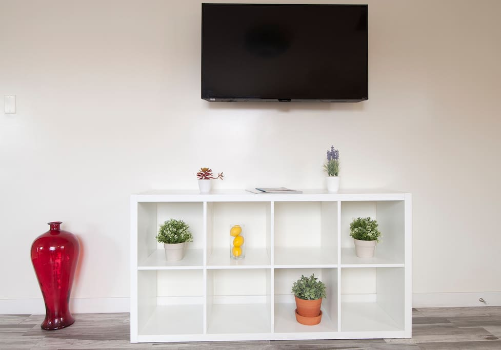 Flat screen wall mounted smart TV with Netflix and Hulu when you feel like relaxing at home.
