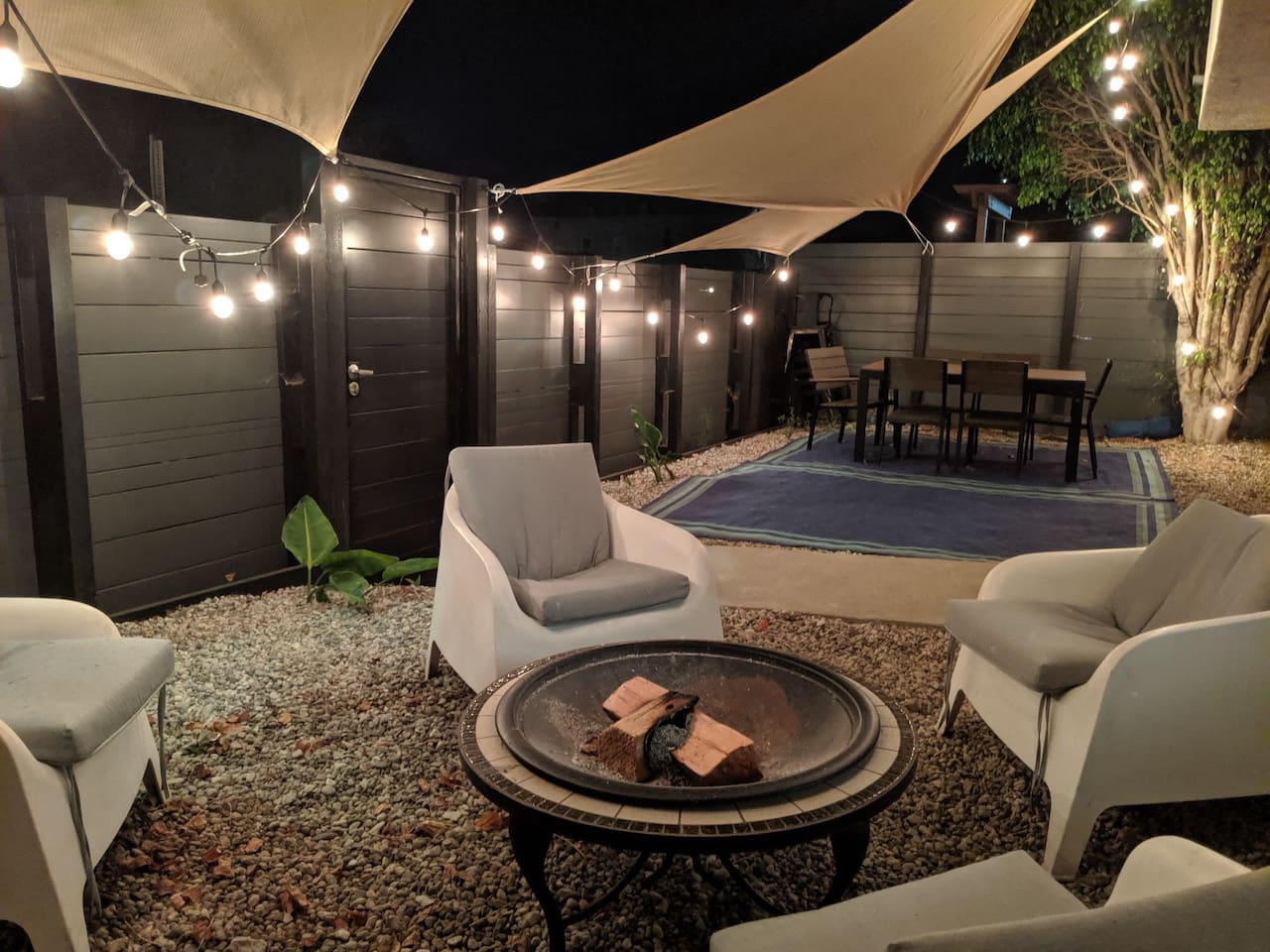 Front yard, with BBQ, dining table and fire pit