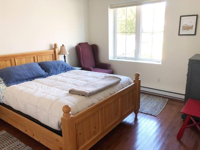 Airy bedroom; queen bed has new premium memory foam mattress.