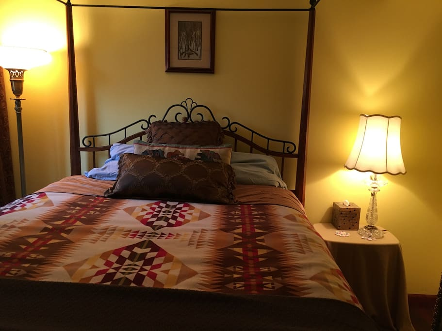 Comfy queen four poster bed in room two is ready for you!