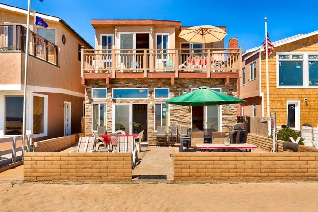 The large beautiful beach front patio has plenty of seating and room for everyone to enjoy their time at the beach