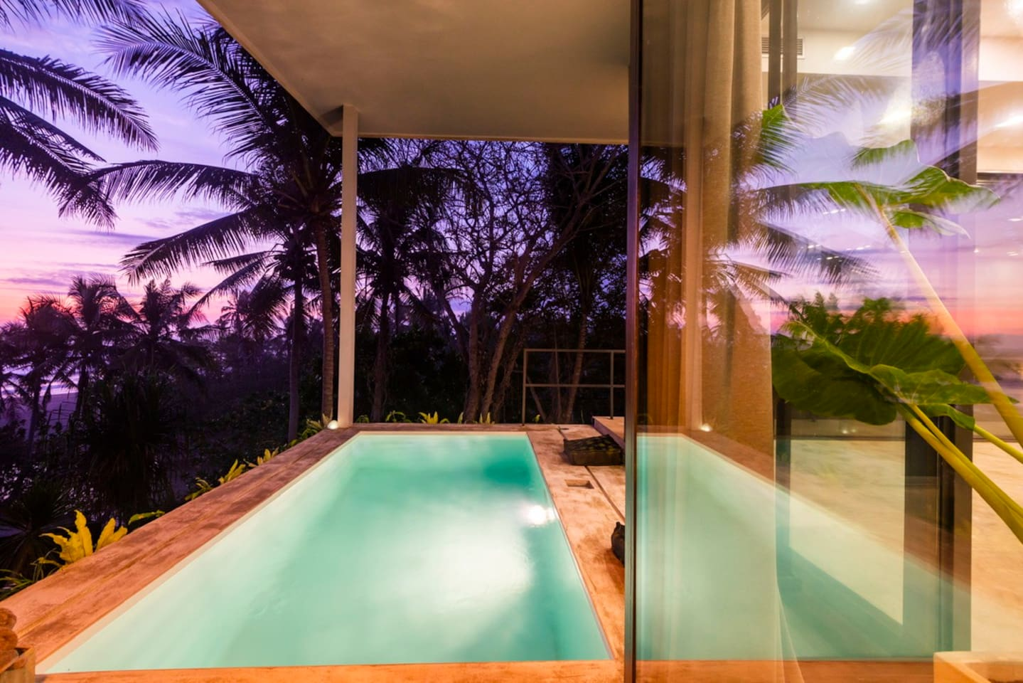 Swimming pool with a view right on the ocean and an amazing sunset