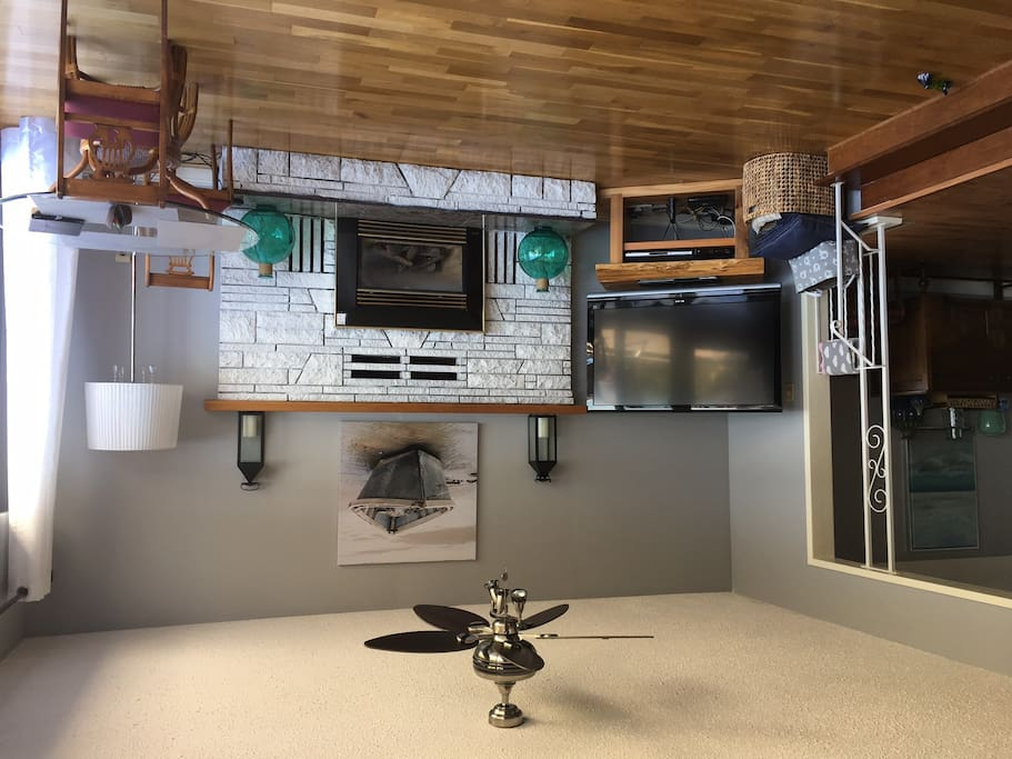 """50"""" TV and natural gas fireplace insert in family room"""