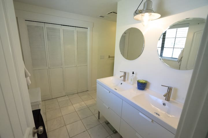 Master bath (1 of 2) has a double vanity and plenty of space for toiletries.