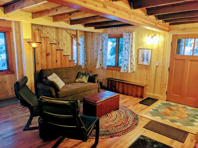 1st floor living room inside front door, sofa bed, stairs to 2nd floor