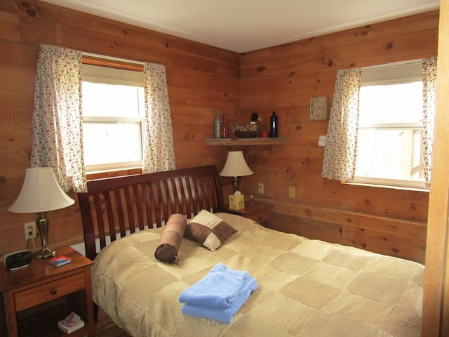 "Bedroom with Double Bed.  This room has a country, cottage feeling  and our ducks are just outside the windows.... our guests LOVE to wake up to the ""whisper"" of our Cayuga Ducks...."