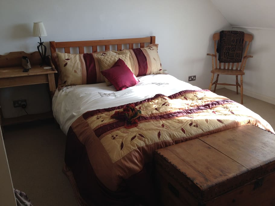Spacious and cosy master bedroom with plenty of space for a cot