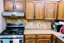 Kitchen with full size appliances: gas stove, refrigerator, microwave, coffee maker. Kitchens utensils are provided.