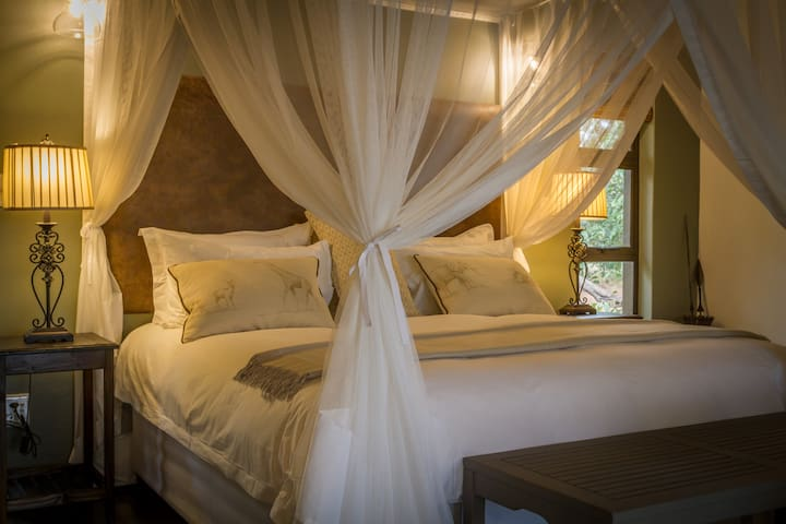 Luxury king sized bed with mosquito netting