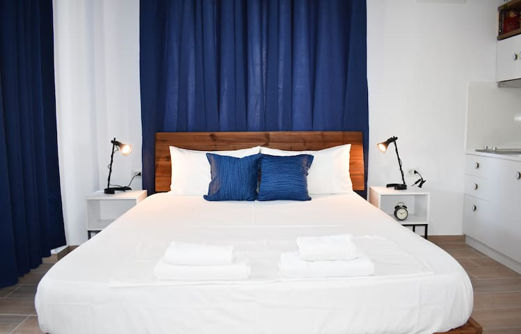 a double bed 190 cm length and 160 cm width.  behind the headboard there are two plug sockets for each side.