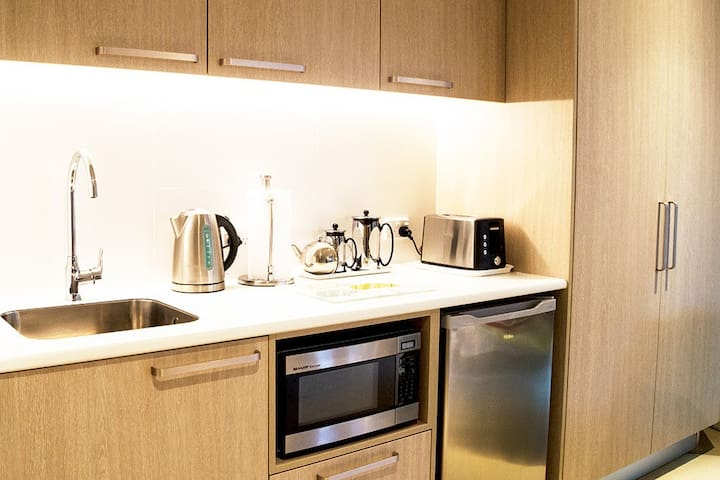 Well equipped kitchenette - microwave; fridge with freezer compartment;  electric jug; toaster; coffee plunger; crockery & cutlery - Parnell Garden Suite