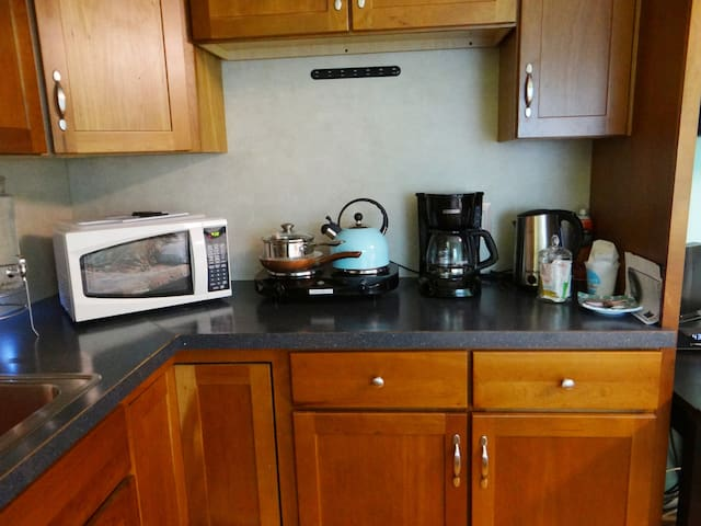 Kitchenette has microwave, mini-fridge, 2-burner hot plate, coffee maker, electric kettle, dishes, utensils, etc.  Self-serve light continental breakfast provided.