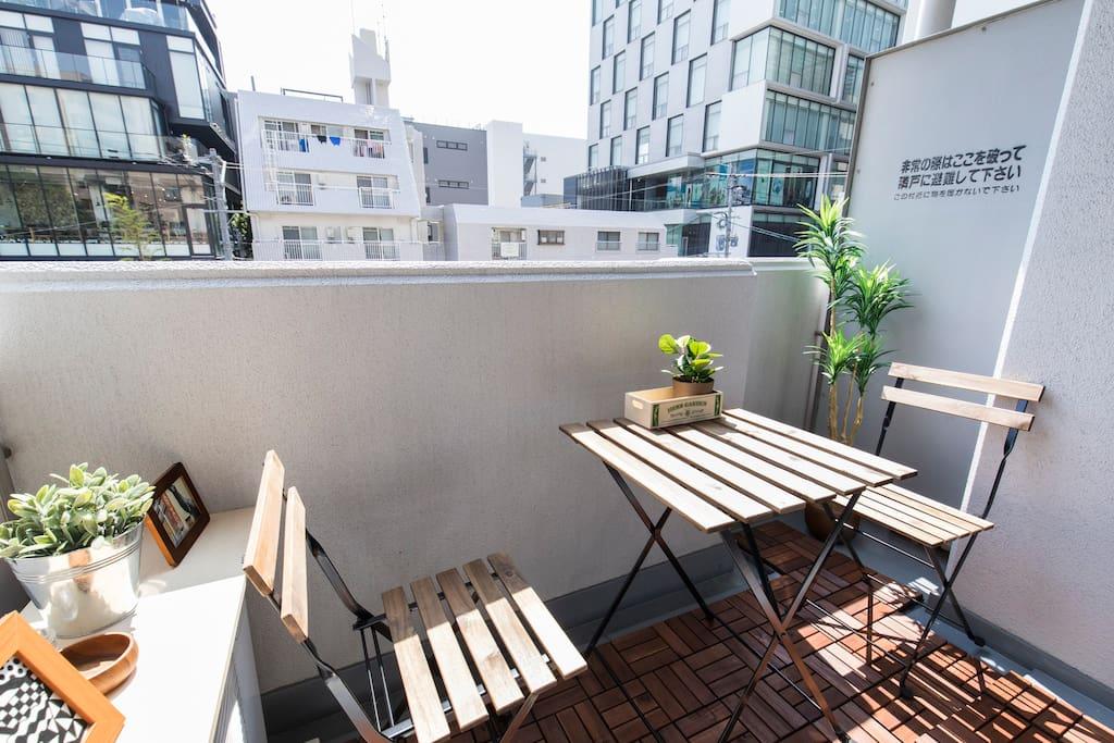 sunny balcony area to checkout the busy Tenjin backstreet