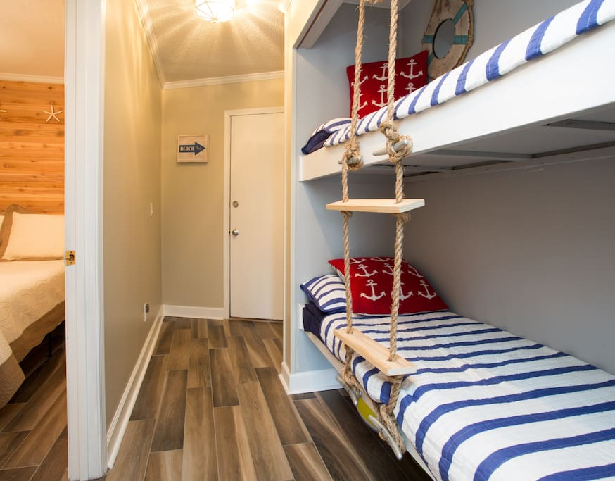 Bunks are located in hallway outside of bedroom door