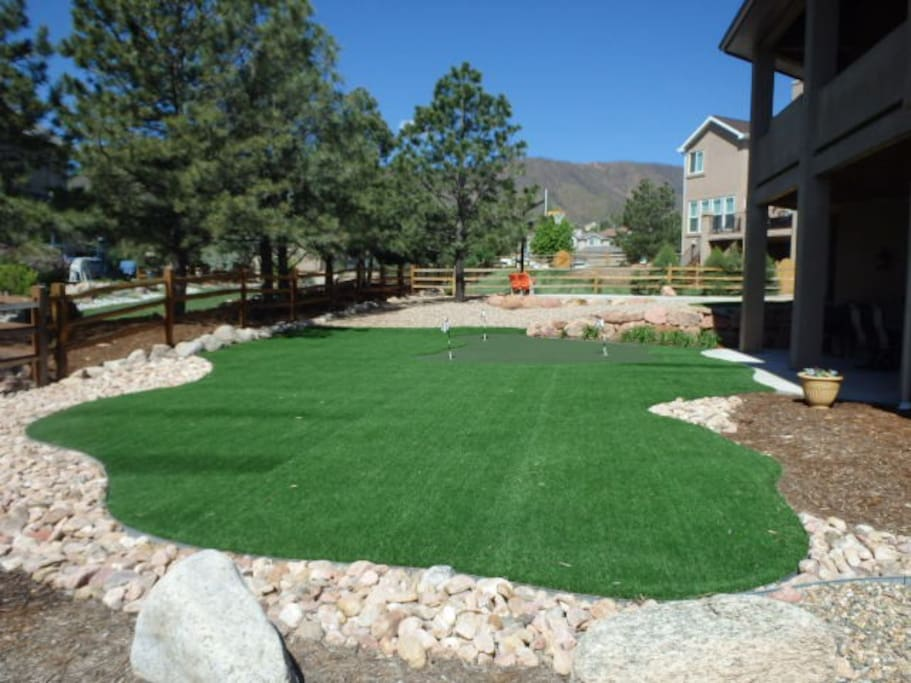 Artificial turf with putting green and chipping area