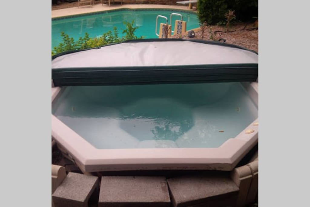 Hot Tub overlooks the large swimming pool in our backyard paradise!