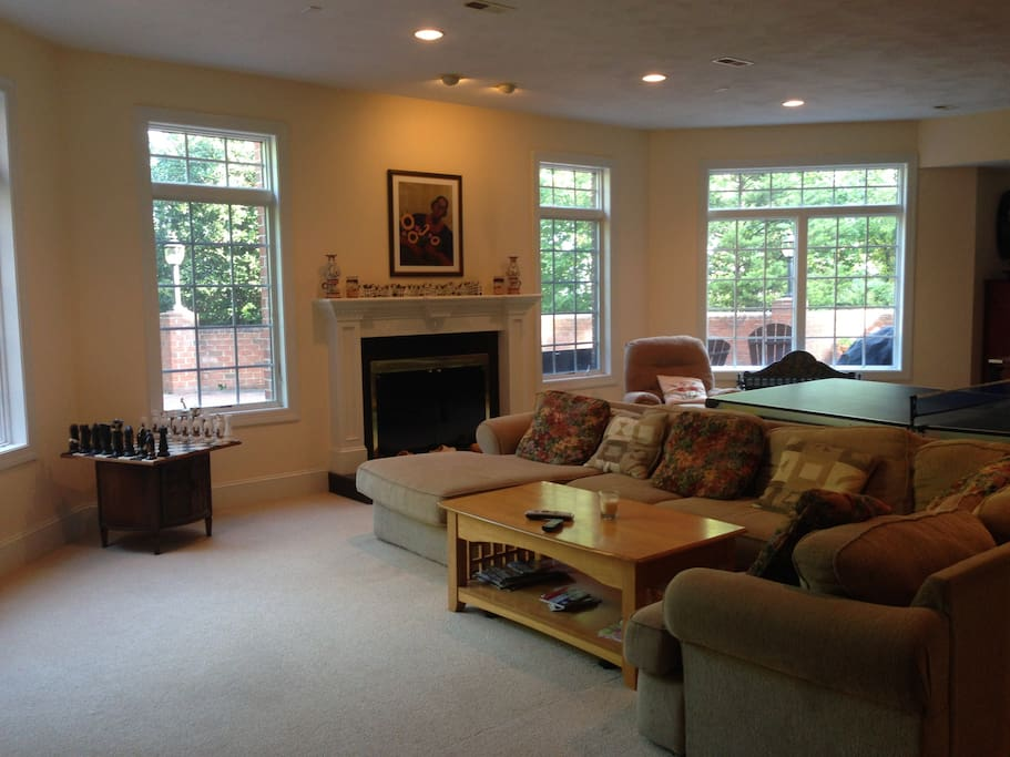 Living room with gas fireplace, ping pong table, foosball table, wide screen TV
