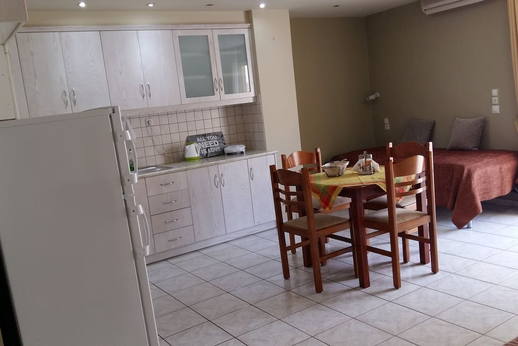 Open plan kitchen living room with TV, WIFI access, air condition,two singels beds and balcony.
