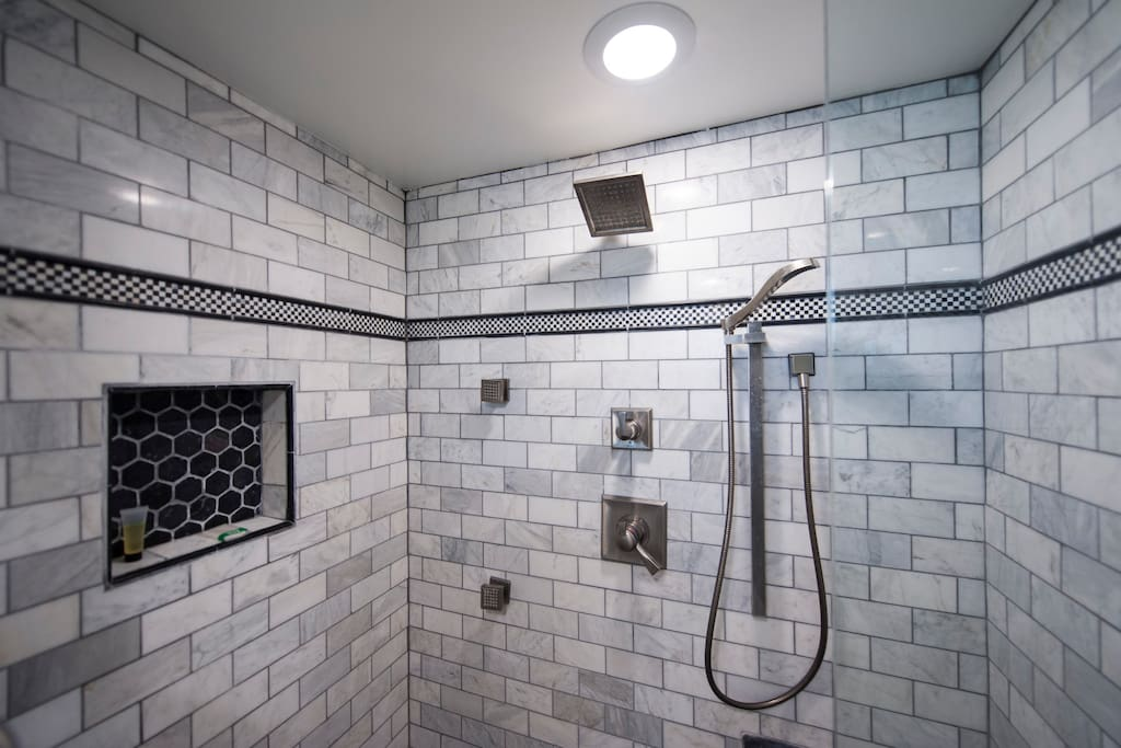 the marble shower has 2 shower heads & 2 body sprays.....