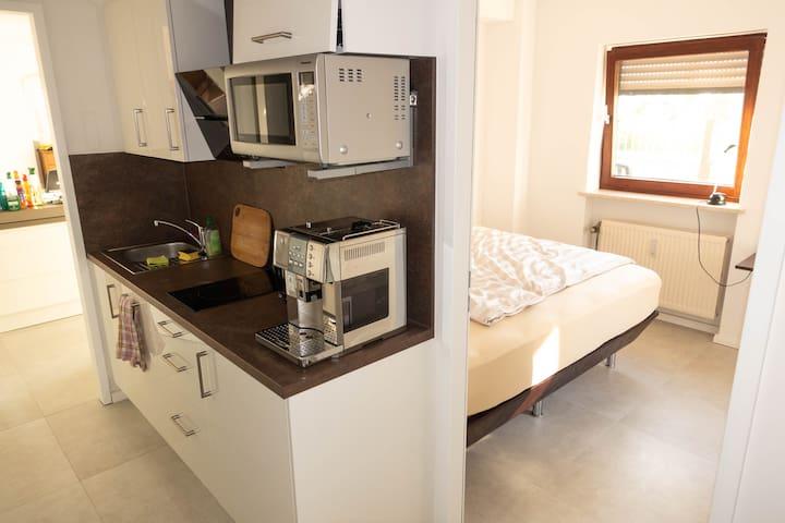 1 Zimmer in einer Penthouse-Wohnung mit Terrasse