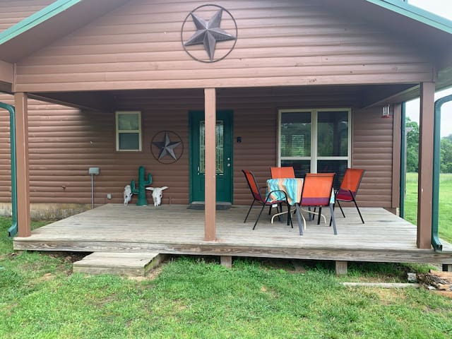 Front porch includes outside table and chairs