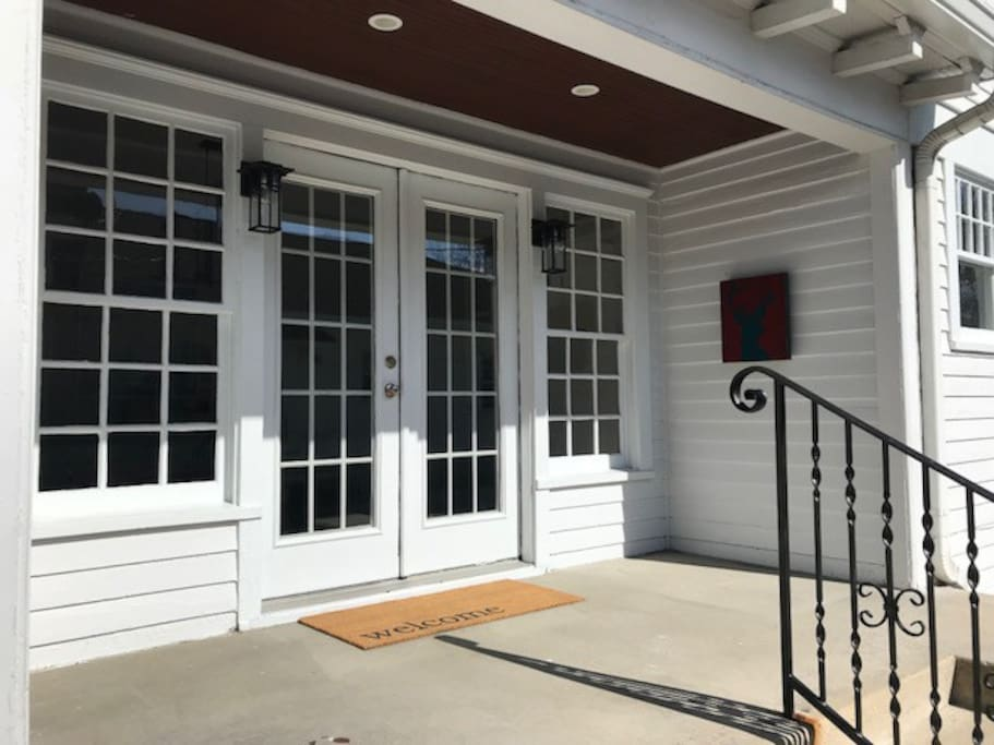 The side entrance is directly off the driveway and accesses the dining room.