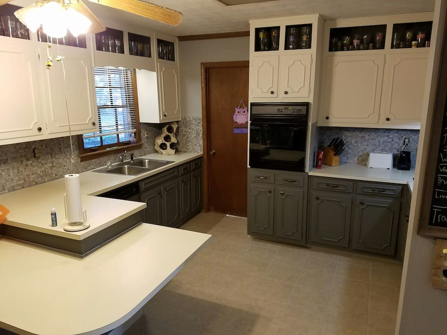 Common kitchen. There is a microwave and a toaster oven. Also to the right there's a stove top
