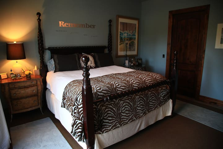 This is one of two beautiful private bedrooms available on the property of OK40 Ranch. Features king size bed and private entrance from patio and pool area.
