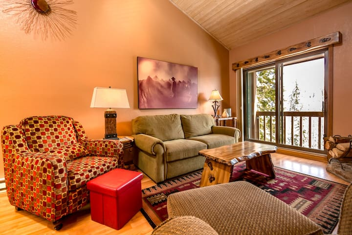 Cozy living room with high end furniture, while enjoying million dollar views through large sliding glass.