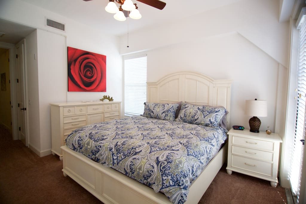 Master bedroom has a king bed and a balcony.