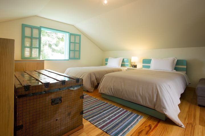 The bedroom with two double beds