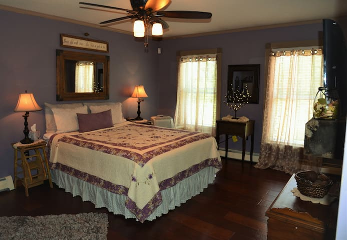 Main master bedroom with a queen bed.