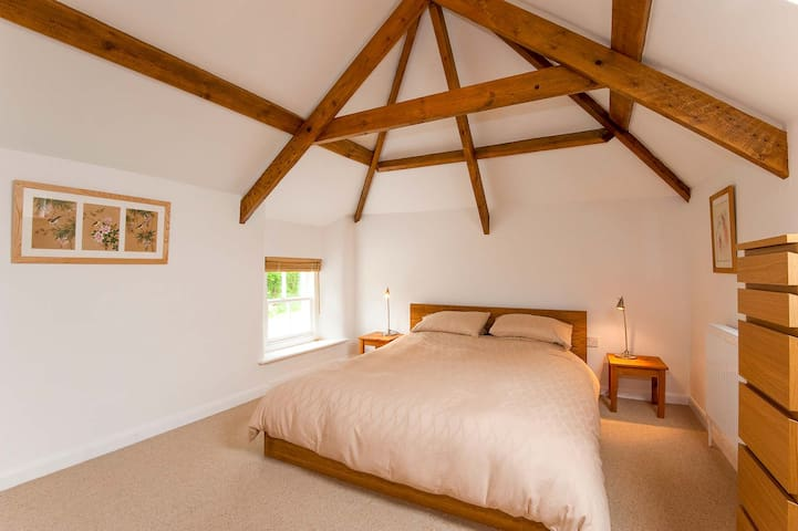 Master bedroom with king size bed and original A-frames
