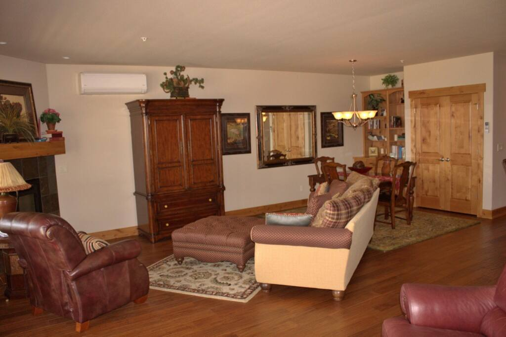 The open, comfy living room is open to dining & kitchen.