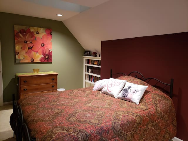 Super comfy bed, tastefully decorated,  with plenty of books to snuggle up with.