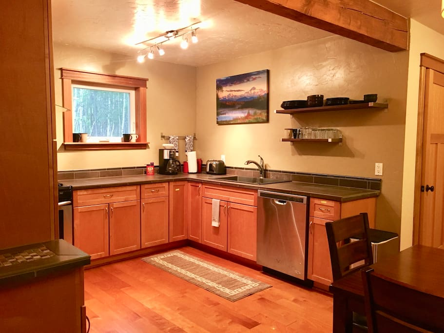 Kitchen with stainless steel appliances incl. dishwasher