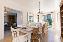 Host dinner parties or sit down together for takeaway with seating for 14 (extendable to 18), cutlery, tableware, glassware all provided.