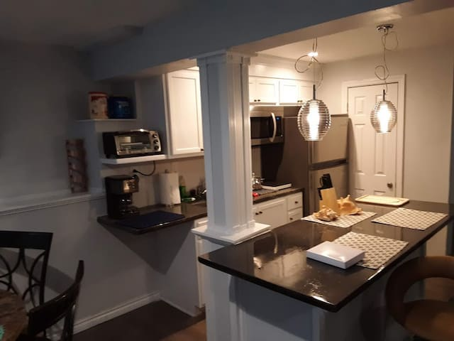 Kitchen area with brand new fridge, microwave, and cooktop. You can enjoy a meal home away from home.
